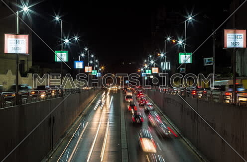 Fixed Shot for traffic from above  Al Thawra Tunnel at Night