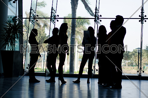 several people in an after meeting finalizing their financial deals