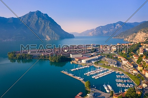 Aerial view of Lake Iseo at sunrise, on the right the port of lovere,background mountains(alps), Bergamo Italy.