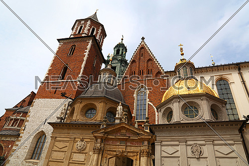Low angle front view of medieval Cathedral of Wawel Royal Castle, one of most popular tourist attractions and landmarks in Krakow, Poland