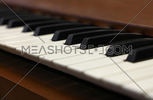 Close up old vintage piano keyboard, low angle view