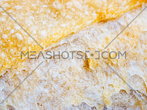 Macro of sourdough bread crust texture. Tasty fresh sourdough bread, close up for background