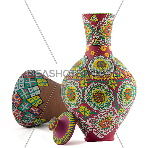 A painted pottery composition of a drinking vessel and a goblet drum on white background