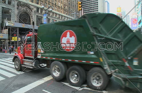 Garbage truck rumbles through New York city at day