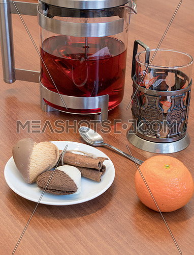 Tea,vegan cookies and mandarine on wooden background
