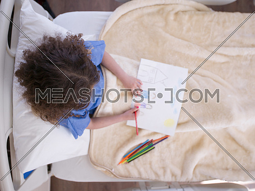 top view of little girl painting home and family at hospita bed