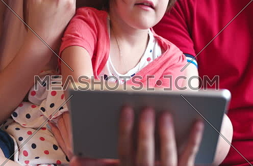 close up for a Family With Kids using technology in modern apartment at day