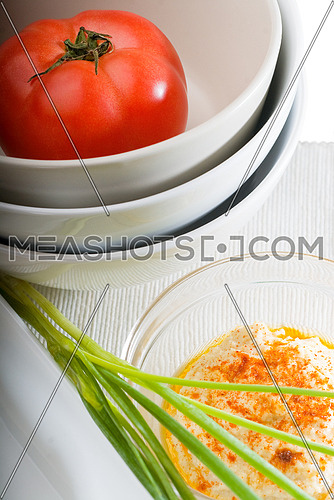 fresh healthy hummus with tomato and chives  typical middle east dish