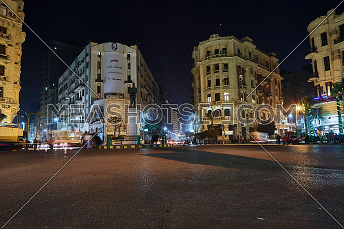 Fixed Shot for traffic at Talat Harb Square at Cairo at Night