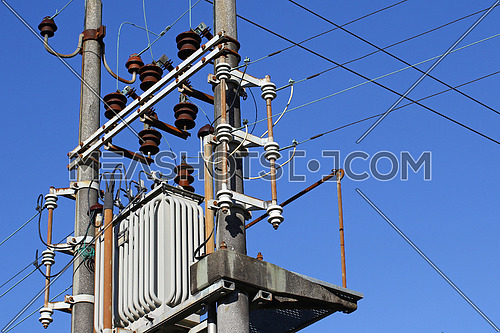 High voltage electrical transformer high on concrete poles