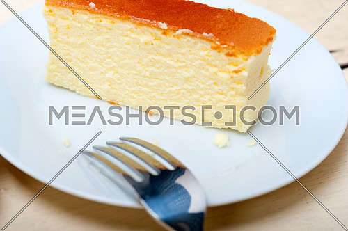 fresh made cheese cake over white wood table