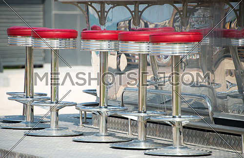 stools in an outdoor take away joint
