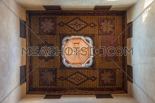 Ottoman era decorated wooden ceiling with floral pattern decorations and wooden dome at historic House of Egyptian Architecture, located in Darb El Labbana district, Cairo, Egypt