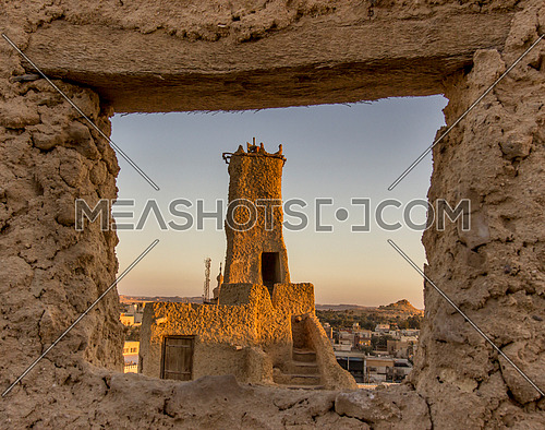 long shot through a window at Shali City The ancient city of Siwa Oasis at day