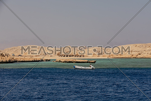 Long shot from the Red Sea showing Ras Muhammed Island by day