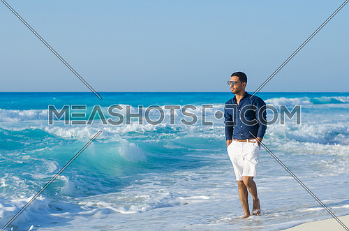 handsome man at the sea