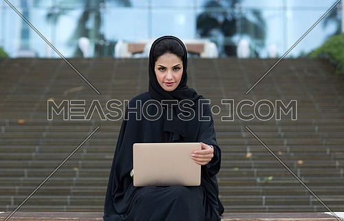 Female employee sitting and working