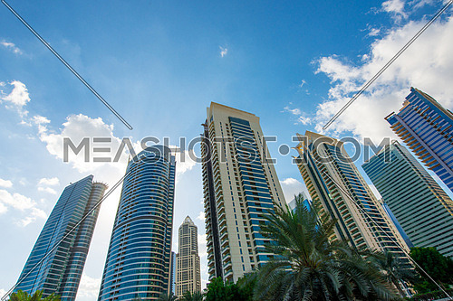 Dubai skyscrapers - blue sky and clouds