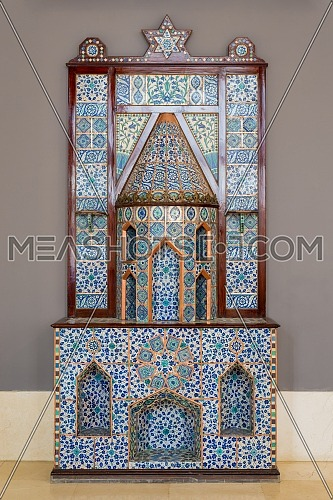 Old Ottoman era style castle shaped fireplace, decorated with floral patterns ceramic tiles from Turkish Iznik town