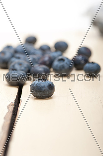 fresh blueberry on white rustic wood table macro