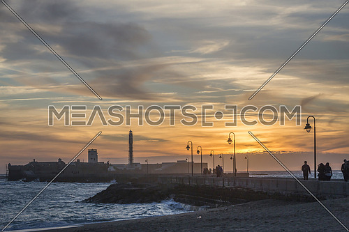 Cadiz Spain- April 1: Castle of San Sebastian at sunset, fortress on a smail island separated from the main city, according classical tradition, there was a Temple of Kronos, cultural landmark of the city, Cadiz, Spain