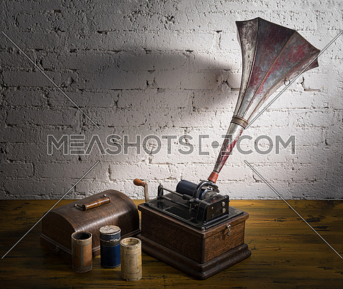 Old Phonograph with three cylinder records
