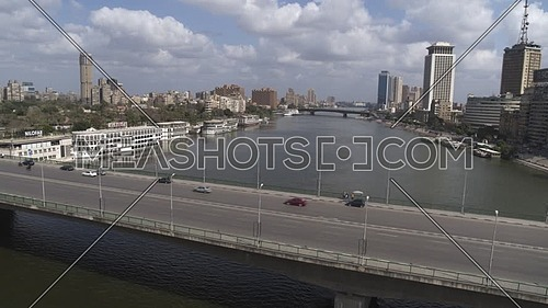 Aerial shot flying over Cairo Downtown empty streets showing The river Nile, 6th of October Bridge during the corona pandemic lockdown by day 10 April 2020