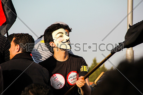 A man wearing anonymous mask in a protest