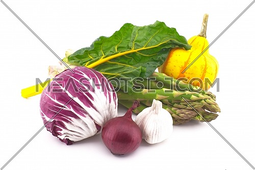 Assortment of fresh colorful including leaf beet, asparagus, radicchio salad, onion and garlic isolated on white background