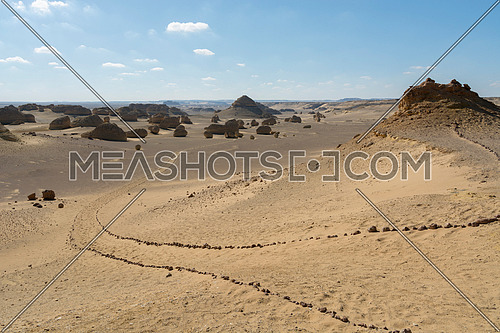 sand and rocks path way in Fayoum Desert Wadi Hitan historical Nature reserve , Egypt