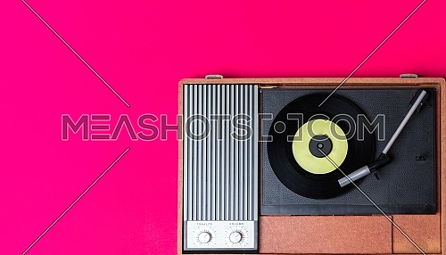 Retro vinyl player and turnable on a background. Entertainment 70s. Listen to music. Top view.