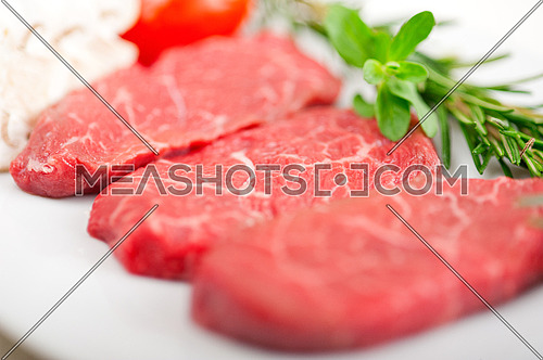 raw fresh Kobe Miyazaky beef with rosmary and marjoram