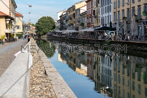 Milan,Italy-september 29,2020:People walk with surgical mask for pandemic situation near the Naviglio Pavese Canal in Milan, Italy.