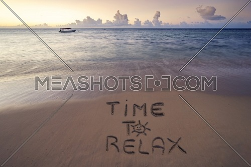 Handwritten Time to relax on sandy beach at sunset,relax and summer concept,Dominican republic beach.