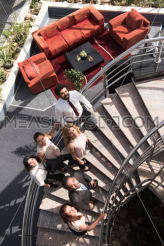 multi ethnic business people group asceding office stairs