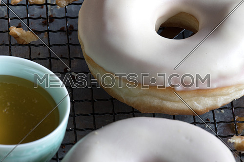 Donuts with nuts beside it and honey