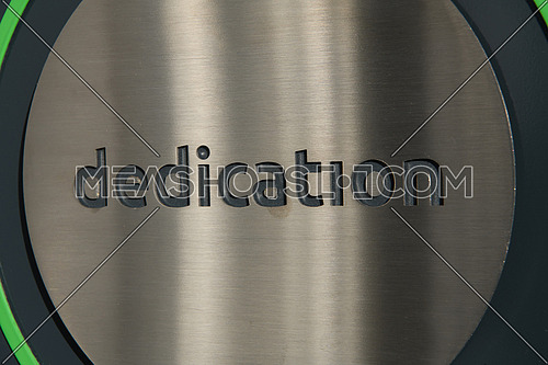 engraving a CNC machine on a piece of metal. Engraving dedication text. High quality photo