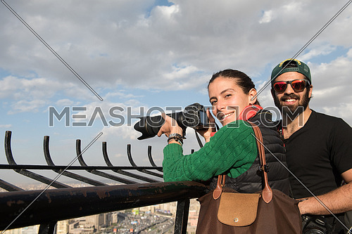 happy tourists taking photos from cairo tower at beautiful sunny day