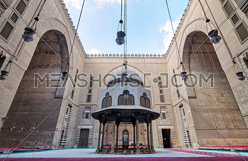 Courtyard of Sultan Hasan Mosque with ablution fountain and huge arches, Old Cairo, Egypt