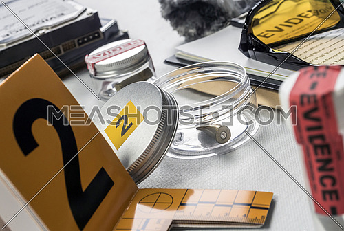 Identification Numbers, various laboratory evidence forensic equipment, conceptual image