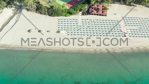 Aerial view of beautiful sea and beach with parasol at sunny day, Simeri Mare, Calabria, Southern Italy