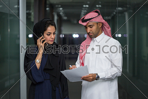 Employee having discussion with his colleague after meeting
