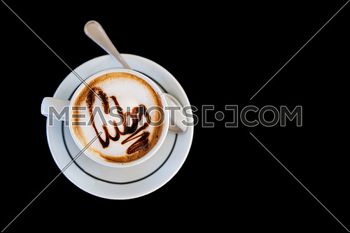 Capuccino on a cup with foam and above the foam the inscription Cuba on a black background