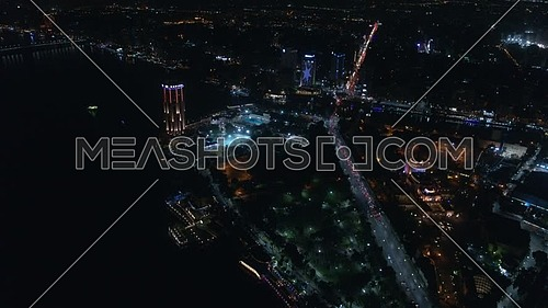 Fly over Cairo City showing the River Nile at night - December 2018.