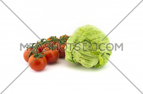 Fresh white cabbage and cherry tomato twig isolated on white background
