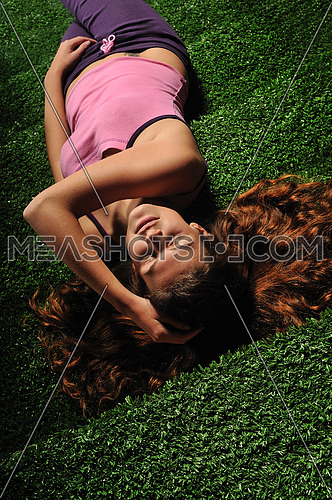 young woman relax on green stairs with speakers around