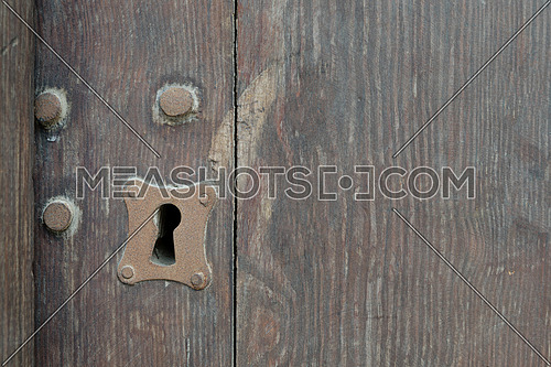 Vintage keyhole in old wooden grunge door