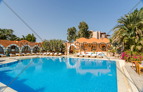 Long shot for a villa and swimming pool in the city of gouna, hurghada, egypt at day