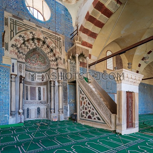 Blue, Iznik ceramic tiles wall with engraved Mihrab (niche) and decorated marble Minbar (Platform) at the Mosque of Aqsunqur (Blue Mosque), Cairo, Egypt