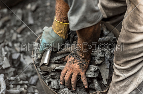 Coal workers cleaning and packaging - labor concept